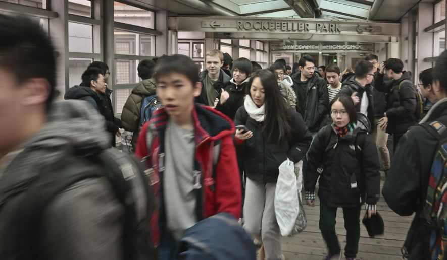 In this March 25, 2014 photo, students leave Stuyvesant High School, one of the nine specialized public high schools in New York City.  (AP Photo/Bebeto Matthews) **FILE**