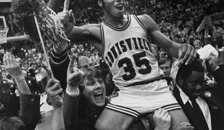 FILE - In this March 24, 1980 file photo, Louisville's Darrell Griffith is hoisted on shoulders of teammates and fans after winning the NCAA basketball championship against UCLA, in Indianapolis. Shaquille O'Neal, Grant Hill and Griffith headline the 2014 College Basketball Hall of Fame class. (AP Photo/Brian Horton, File)
