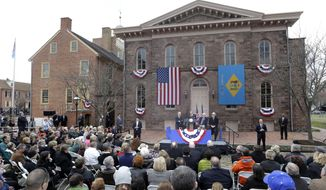 FILE - In this March 26, 2013 file photo, Sen. Tom Carper, D-Del. speaks during a ceremony in New Castle, Del. at First State National Monument, which was designated a national monument by President Barack Obama. The House takes up a bill aimed at limiting President Barack Obama's ability to designate new national monuments. Obama created five new monuments last year, using executive authority to protect historic or ecologically significant sites. Republicans say the bill would not block new monuments, but would require greater public participation in such decisions. Seated behind Carper are, from left, Vice President Joe Biden, New Castle, Del. Mayor Donald Reese and Interior Secretary Ken Salazar. The monument is the first step toward creating a national park in Delaware, the only state not included in the national park system. (AP Photo/Patrick Semansky, File)