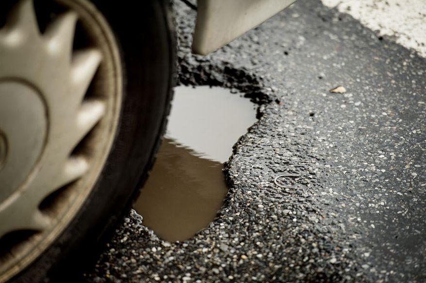 potholes along Florida Ave. in Northwest, Washington, D.C., Wednesday, March 19, 2014. (Andrew Harnik/The Washington Times)