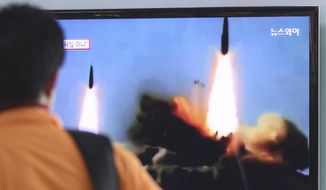 A man watches a TV news program showing the missile launch conducted by North Korea, at Seoul Railway Station in Seoul, South Korea, Wednesday, March 26, 2014. North Korea test-fired two medium-range ballistic missiles on Wednesday, South Korea and the U.S. said, a defiant challenge to a rare three-way summit of its rivals Seoul, Tokyo and Washington that focused on the North's security threat.(AP Photo/Ahn Young-joon)