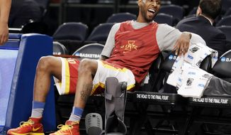 Iowa State's guard DeAndre Kane laughs from a seat at Madison Square Garden during practice at the NCAA college basketball tournament in New York, Thursday, March 27, 2014. Iowa State plays Connecticut in a regional semifinal on Friday. (AP Photo/Seth Wenig)