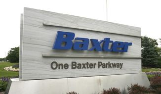 FILE - This July 2009 file photo shows the sign outside Baxter International Inc. in Deerfield, Ill. Baxter International Inc. on Thursday, March 27, 2014 announced it is splitting itself into two separate businesses _ one focusing on biopharmaceuticals and the other on other medical products. (AP Photo/Arlington Heights Daily Herald, George LeClaire, File) MANDATORY CREDIT; MAGS OUT