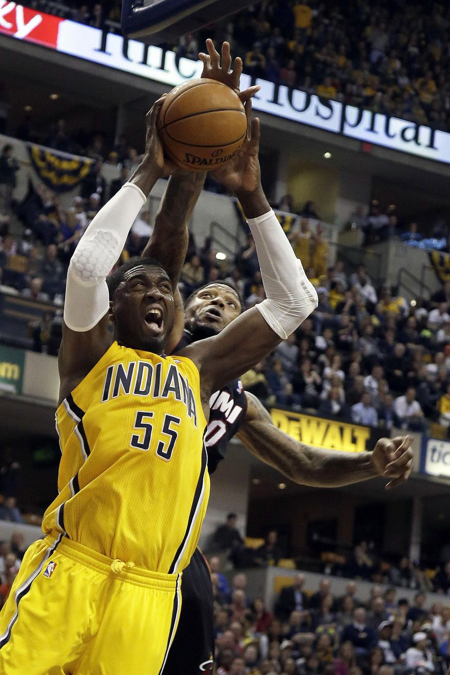 Indiana Pacers center Roy Hibbert (55) shoots in front of Miami Heat forward Udonis Haslem during the second half of an NBA basketball game in Indianapolis, Wednesday, March 26, 2014. The Pacers won 84-83. (AP Photo/AJ Mast)