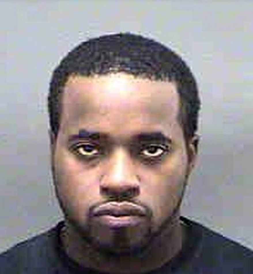 This undated photo released by the Mecklenburg (N.C.) County Sheriff's Office, shows Jeffrey Tyrone Savage, who, according to the Navy on Thursday, March 27, 2014,  is the civilian who shot and killed a sailor aboard a guided-missile destroyer at the Naval Station Norfolk in Norfolk, Va., earlier this week. Savage was killed by Navy security forces aboard the USS Mahan on Monday, March 24, after he disarmed the ship's petty officer of the watch and used her gun to shoot Petty Officer 2nd Class Mark Mayo. (AP Photo/Mecklenburg (N.C.) County Sheriff's Office via The Virginian-Pilot)