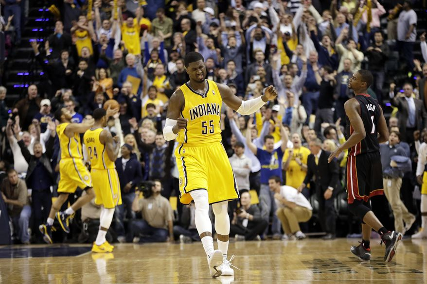 Indiana Pacers center Roy Hibbert (55) reacts after defeating the Miami Heat in an NBA basketball game in Indianapolis, Wednesday, March 26, 2014. The Pacers won 84-83. (AP Photo/AJ Mast)