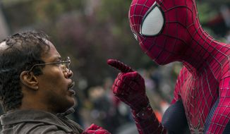 """This photo provided by Sony Pictures shows Jamie Foxx, as Max Dillon, left, and Andrew Garfield as Spider-Man, in Columbia Pictures' """"The Amazing Spider-Man 2.""""  Sony Pictures debuted 30 minutes of 3-D footage of """"The Amazing Spider-Man 2"""" at the movie-theater convention, CinemaCon, in Las Vegas on Wednesday night, March 26, 2014. (AP Photo/Sony Pictures, Niko Tavernise)"""