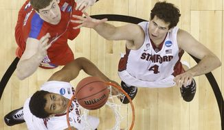 Stanford center Stefan Nastic (4) and Dayton forward/center Matt Kavanaugh (35) vie for a loose ball during the first half in a South regional semifinal game at the NCAA Tournament on Thursday in Memphis, Tenn. (Associated Press)