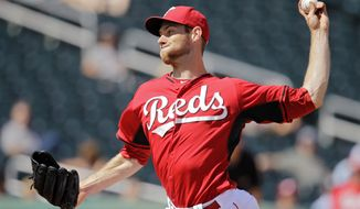 Cincinnati Reds starting pitcher Tony Cingrani delivers against the Arizona Diamondbacks in the seventh inning of a spring exhibition baseball game on Thursday, March 27, 2014, in Goodyear, Ariz. (AP Photo/Mark Duncan)