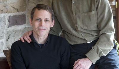 In this March 23, 2014 photo, Carl Bechdel, left, and his husband Dan Miller, pose for a photograph at their home in Harrisburg, Pa. It took two months of near daily phone calls and emails to an insurer for Bechdel and Miller to get family coverage under the federal health law. The couple was initially told their application was not processed because Pennsylvania doesn't recognize their marriage. Gay couples are finding that access to such family plans is not guaranteed, as the Obama administration seeks belatedly to ensure equitable coverage is available for same-sex spouses.  (AP Photo/Matt Rourke)