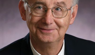 This undated photo provided by Eastern Illinois University in Charleston, Ill., shows university President Bill Perry. Perry announced Thursday, March 27, 2014, that he plans to retire in 2015, stepping down from the post when his contract expires next June. He joined the university in Charleston in 2007 after spending more than 30 years working at Texas A&M University. (AP Photo/Courtesy of Eastern Illinois University)