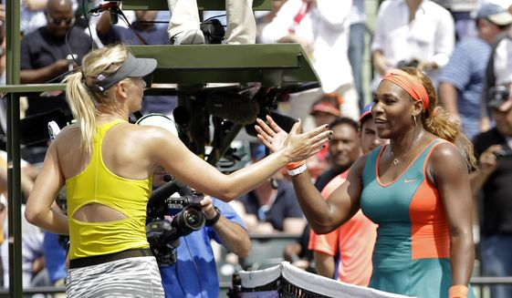 Maria Sharapova, of Russia, left, congratulates Serena Williams at the Sony Open tennis tournament in Key Biscayne, Fla., Thursday, March 27, 2014. Willaims won 6-4, 6-3. (AP Photo/Alan Diaz) **FILE**