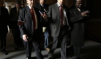 Assembly Speaker Sheldon Silver, D-Manhattan, left, talks with reporters on his way to a budget meeting at Gov. Andrew Cuomo's office at the Capitol on Thursday, March 27, 2014, in Albany, N.Y. (AP Photo/Mike Groll)