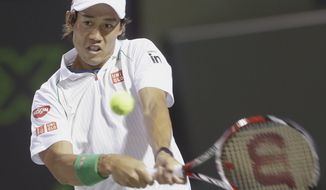 Kei Nishikori of Japan, returns a shot from Roger Federer of Switzerland, at the Sony Open Tennis tournament, Wednesday, March 26, 2014 in Key Biscayne, Fla. (AP Photo/Wilfredo Lee)