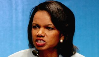 "U.S. Secretary of State Condolleeza Rice gestures as she speaks to the media during a press conference at the ASEAN Regional Forum in Kuala Lumpur, Malaysia, Friday, July 28, 2006.  Rice said Friday that southeast Asian nations had made ""an important evolution"" in dealing with Myanmar's junta and called for the quick release of dissident Aun San Suu Kyi.   (AP Photo/Dita Alangkara)"