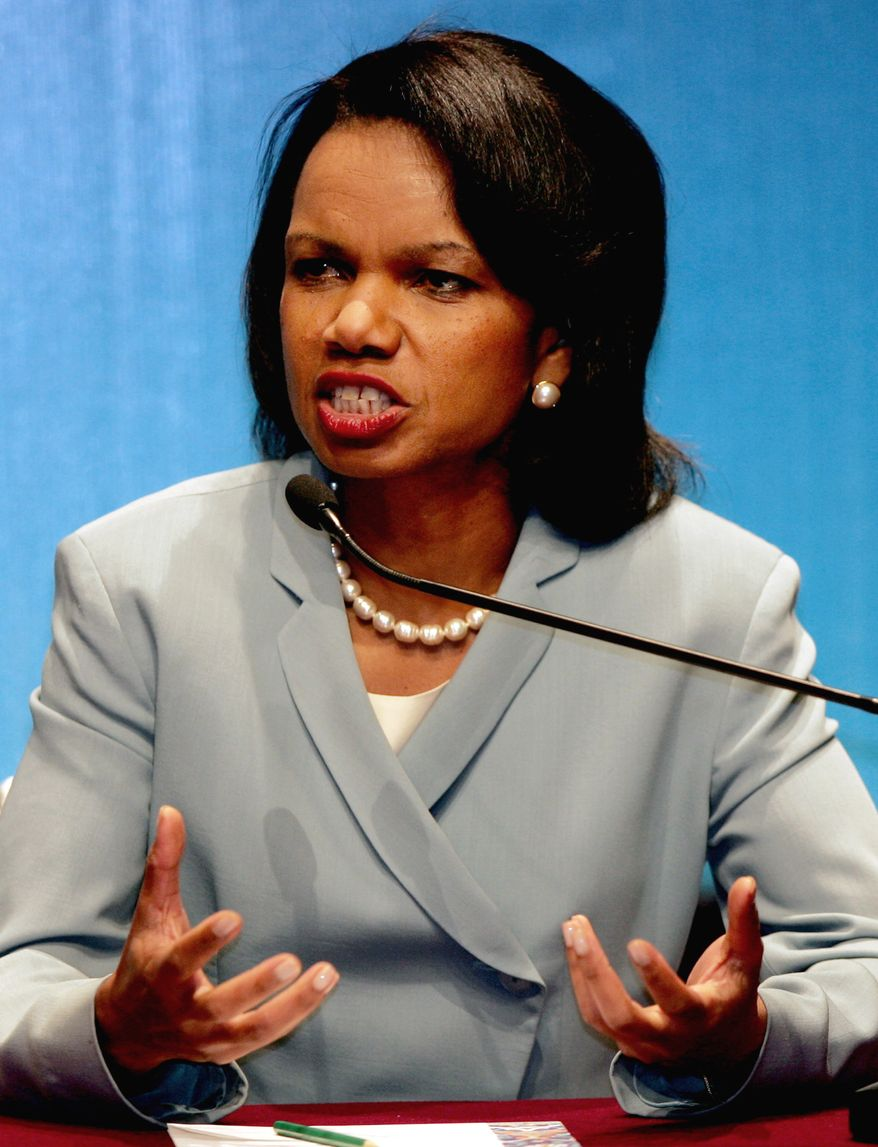 """U.S. Secretary of State Condolleeza Rice gestures as she speaks to the media during a press conference at the ASEAN Regional Forum in Kuala Lumpur, Malaysia, Friday, July 28, 2006.  Rice said Friday that southeast Asian nations had made """"an important evolution"""" in dealing with Myanmar's junta and called for the quick release of dissident Aun San Suu Kyi.   (AP Photo/Dita Alangkara)"""