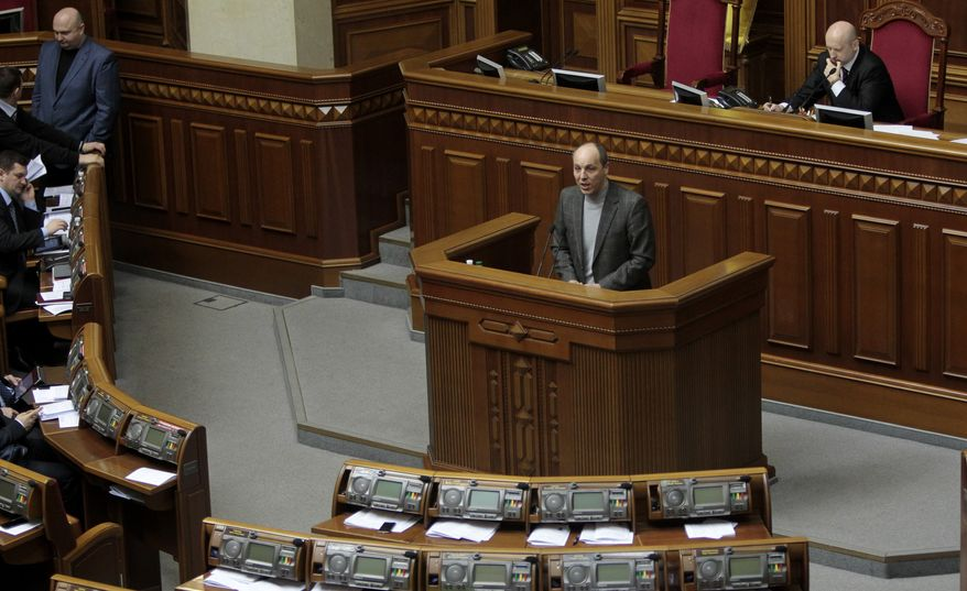 **FILE** Andriy Parubiy, Secretary of Ukraine's National Security and Defense Council, speaks to lawmakers during a session of the parliament in Kiev on March 13, 2014. (Associated Press)
