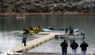 This photo released by Ouray County, shows Ouray County, federal officials and Beegles Aircraft Service Inc. of Greeley, Colo., preparing salvage operations to recover the victims and plane, Thursday March 27, 2014, at the Ridgway Reservoir near Ridgway, Colo., at the site of a downed aircraft, The plane crashed on Saturday, March 22, 2014, killing five people from Alabama. (AP Photo/Ouray County, William Woody)