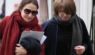 CAPTION CORRECTS THE SURNAME OF THE DAUGHTER TO BEREZOVSKAYA Russian oligarch Boris Berezovsky's daughters Elizaveta, right and Ekatrina arrive for the second day of the inquest into his death at Windsor Coroner's Court, in Windsor, England,  Thursday, March, 27, 2014. Elizaveta Berezovskaya is due to appear as a witness on the second day of the hearing into the death of the tycoon.  He was found dead at his former wife's property,  in March 2013. (AP Photo/Alastair Grant)