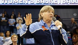 """FILE - In this Jan. 5, 2014 file photo, North Carolina head coach Sylvia Hatchell addresses the crowd at halftime of an NCAA women's college basketball game against Maryland, in Chapel Hill, N.C. Hatchell says she could return to coaching while battling leukemia if the Tar Heels reach the Final Four. Fourth-seeded UNC  faces No. 1 seed South Carolina in California at this weekend's Stanford Regional. If her team advances, Hatchell said Thursday, March 27, 2014, her doctor has told her that being on the sideline in Nashville, Tenn., is """"very doable."""" (AP Photo/Ellen Ozier, File)"""