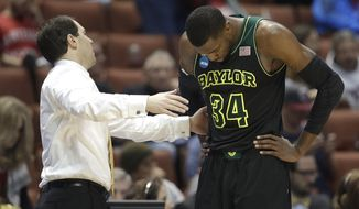 Baylor coach Scott Drew talks with Cory Jefferson during the second half against Wisconsin in an NCAA men's college basketball tournament regional semifinal, Thursday, March 27, 2014, in Anaheim, Calif. Wisconsin won 69-52. (AP Photo/Jae C. Hong)