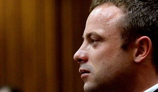 FILE: In this file photo taken Monday March 10, 2014, Oscar Pistorius cries as he listens to cross questioning about the events surrounding the shooting death of his girlfriend Reeva Steenkamp, in court during his trial in Pretoria, South Africa. Pistorius is expected to testify soon at his murder trial when the defense begins its case on Friday after four weeks of prosecution-led testimony. (AP Photo/Bongiwe Mchunu, Pool, File)