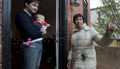 D.C. Councilmember Muriel Bowser, right, one of seven Democrats trying to unseat the incumbent District of Columbia Mayor Vincent Gray in next week's primary, talks to Jason Ladnier, holding his one-year-old son Sebastian, as she goes knocking door-to-door campaigning on Capitol Hill neighborhood in Washington, Thursday, March 27, 2014. Loyalists are rallying around the mayor, and few are writing him off. But his troubles have provided an opening for one of his challengers, and D.C. Councilmember Muriel Bowser appears to be taking advantage. Two polls released a week before the primary showed Bowser in a statistical tie with Gray.  (AP Photo/Manuel Balce Ceneta)