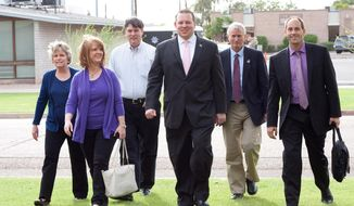 In this photo taken on Wednesday, March 26, 2014, Arizona Republican State Representatives, from left, Kate Brophy-McGee, Heather Carter, Bob Robson, Jeff Dial, Doug Coleman and Ethan Orr walk together after leaving the Arizona House of Representatives in Phoenix. The group announced earlier that they had broken off talks with GOP House leaders because of a lack of progress on their push for more education and child welfare spending. (AP Photo/Arizona Capitol Times, Evan Wyloge)