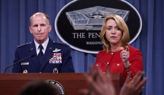 Air Force Secretary Deborah Lee James, accompanied by Air Force Global Strike Command (AFGSC) Commander Lt. Gen. Stephen Wilson, take questions during a news conference at the Pentagon, Thursday, March 27, 2014. The Air Force is firing nine mid-level commanders and disciplining dozens of junior officers at a nuclear missile base in response to an exam-cheating scandal that spanned a far longer period than originally reported. (AP Photo/Charles Dharapak)