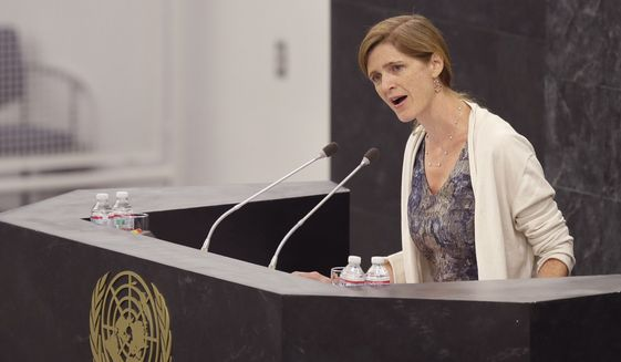 "United States Ambassador to the United Nations Samantha Power speaks at United Nations headquarters, Thursday, March 27, 2014.  The draft resolution of the U.N. General Assembly on Ukraine is ""confrontational in nature"", Russian Permanent Representative to the United Nations Vitaly Churkin said on Thursday, March 27. ""Russia's attitude towards the proposed draft resolution is negative. It is confrontational in nature,"" he said before the vote in the U.N. General Assembly. (AP Photo/Seth Wenig)"