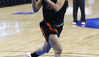 Oklahoma State guard Tiffany Bias drives during an NCAA women's college basketball tournament practice at the Purcell Pavilion in South Bend, Ind., Friday, March 28, 2014. Oklahoma State plays Notre Dame on Saturday. (AP Photo/Paul Sancya)