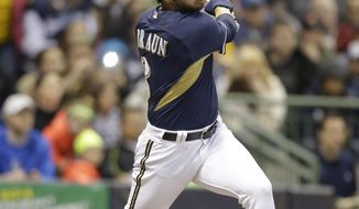 Milwaukee Brewers' Ryan Braun watches his double against the Kansas City Royals in the first inning of an exhibition baseball game Friday, March 28, 2014, in Milwaukee. (AP Photo/Jeffrey Phelps)