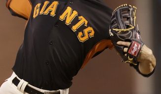 San Francisco Giants pitcher Tim Lincecum throws against the Oakland Athletics during the second inning of a spring exhibition baseball game in San Francisco, Friday, March 28, 2014. (AP Photo/Jeff Chiu)