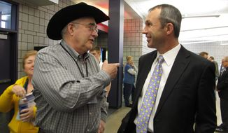 North Dakota Democratic convention delegate Dean Meyer, left, talks with the party's nominee for state agriculture commissioner, Ryan Taylor, during events Friday, March 28, 2014, in Fargo, N.D. (AP Photo/Dave Kolpack)