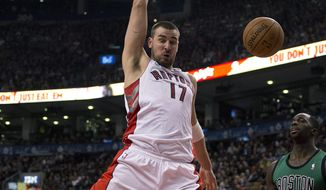 Toronto Raptors centre Jonas Valanciunas (17) slams home a dunk against Boston Celtics forward Jeff Green (8) during first half NBA action in Toronto on Friday March 28, 2014. (AP Photo/The Canadian Press, Frank Gunn)