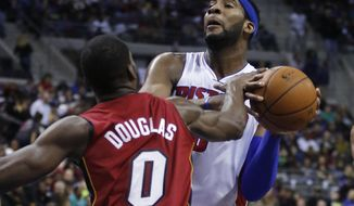 Miami Heat guard Toney Douglas (0) knocks the ball out of the hands of Detroit Pistons center Andre Drummond, right, during the first half of an NBA basketball game on Friday, March 28, 2014, in Auburn Hills, Mich. (AP Photo/Duane Burleson)