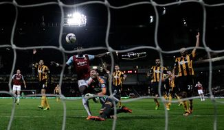 Hull City's goalkeeper Allan McGregor, center right, brings down West Ham's Mohamed Diame, center left, for a penalty and was red carded for the challenge during the English Premier League soccer match between West Ham and Hull City at Upton Park stadium in London, Wednesday, March 26, 2014.  (AP Photo/Matt Dunham)