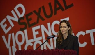 UNHCR goodwill ambassador Angelina Jolie speaks during a conference in Sarajevo, Bosnia, on Friday March 28, 2014. British Foreign Secretary William Hague and Hollywood star Angelina Jolie addressed a conference organized in Sarajevo by Bosnia's Defense Ministry on sexual violence in conflict. (AP Photo/Sulejman Omerbasic)