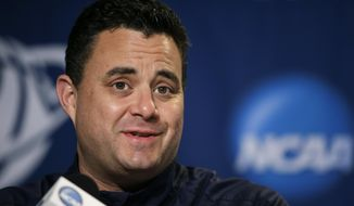 Arizona head coach Sean Miller speaks during a news conference at the NCAA college basketball tournament on Friday, March 28, 2014, in Anaheim, Calif. Arizona plays Wisconsin in a regional final on Saturday. (AP Photo/Jae C. Hong)