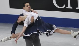 Anna Cappellini and Luca Lanotte of Italy perform during the ice dance short dance event of the World Figure Skating Championships in Saitama, near Tokyo, Friday, March 28, 2014. (AP Photo/Koji Sasahara)