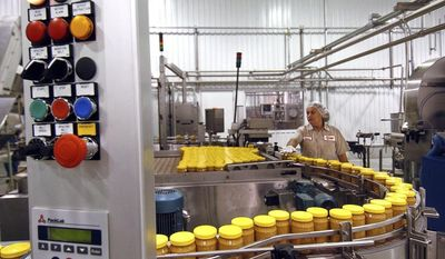 FILE - An Aug. 10, 2005 file photo shows the peanut butter production line at Sunland Inc's peanut plant in Portales, N.M. Nearly a million jars of peanut butter are being dumped at a New Mexico landfill to expedite the sale of Sunland Inc. the bankrupt peanut-processing plant that was at the heart of a 2012 salmonella outbreak and nationwide recall.   (AP Photo/Albuquerque Journal, Richard Pipes)