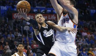 Sacramento Kings guard Ray McCallum (3) shoots in front of Oklahoma City Thunder forward Nick Collison during the second quarter of an NBA basketball game in Oklahoma City, Friday, March 28, 2014. (AP Photo/Sue Ogrocki)