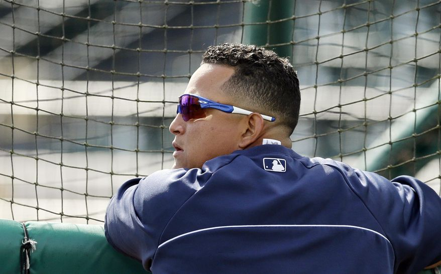 Detroit Tigers first baseman Miguel Cabrera watches batting practice before a spring exhibition baseball game against the Tampa Bay Rays in Lakeland, Fla., Friday, March 28, 2014. (AP Photo/Carlos Osorio)