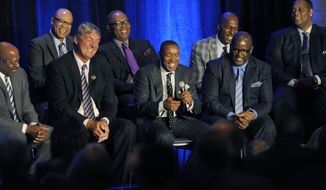"Isiah Thomas, center, and from left,  Bill Lamibeer and Joe Dumars reminisce during a fundraiser on Thursday, March 27, 2014 in Detroit.   Thomas,  Laimbeer, Vinnie Johnson and other players from the 1988-89 and '89-90 teams took part in ""Bad Boys Unite,"" which raised money for six nonprofit organizations in southeast Michigan, including the Jalen Rose Leadership Academy. (AP Photo/Detroit News, Clarence Tabb, Jr)  DETROIT FREE PRESS OUT; HUFFINGTON POST OUT"