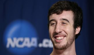 Wisconsin's Frank Kaminsky answers questions from members of the media during a news conference at the NCAA college basketball tournament on Friday, March 28, 2014, in Anaheim, Calif. Wisconsin plays Arizona in a regional final on Saturday. (AP Photo/Jae C. Hong)