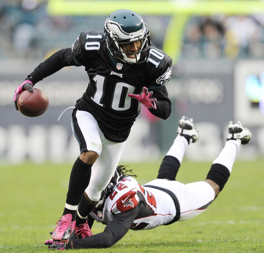 FILE - In this Oct. 28, 2012 file photo shows Philadelphia Eagles wide receiver DeSean Jackson (10) avoiding a tackle by Atlanta Falcons cornerback Asante Samuel (22) during the second half of an NFL football game in Philadelphia. The Eagles have released Jackson. The team cut Jackson on Friday, March 28, 2014. He was coming off a career-best season in Philadelphia, leading the team with 82 catches for 1,332 yards and nine touchdowns.(AP Photo/Michael Perez, File)