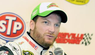 NASCAR Sprint Cup driver Dale Earnhardt Jr. speaks to the media during a press conference prior to practice at Martinsville Speedway in Martinsville, Va., Friday March 28, 2014. (AP Photo/Mike McCarn)
