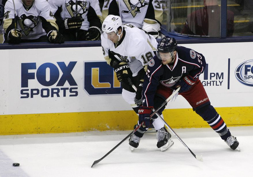 Columbus Blue Jackets' Mark Letestu (55) and  Pittsburgh Penguins' James Neal (18) tangle during the third period of an NHL hockey game, Friday, March 28, 2014, in Columbus, Ohio. (AP Photo/Mike Munden)