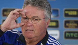 FILE - In this Wednesday March 6, 2013 file photo, Anzhi's head coach Guus Hiddink speaks during a news conference, at Luzhniki stadium in Moscow, Russia. Guus Hiddink will take over as Netherlands coach after the World Cup, when Louis van Gaal is stepping down, the country's football association announced on Friday March 28, 2014. (AP Photo/Ivan Sekretarev, File)