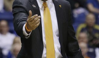 Tennessee head coach Cuonzo Martin yells during the first half of an NCAA Midwest Regional semifinal college basketball tournament game against the Michigan Friday, March 28, 2014, in Indianapolis. (AP Photo/David J. Phillip)